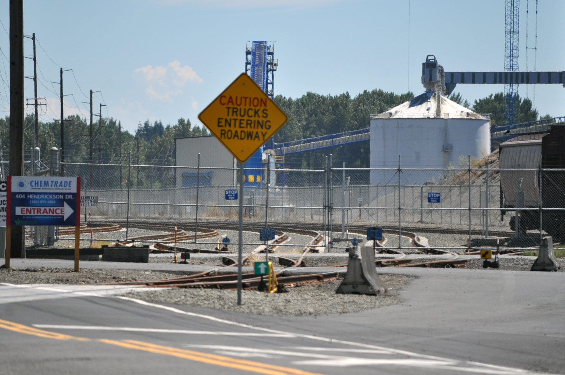 "Grain Terminal Rail Modifications Caution Sign saying ""Trucks entering Roadway"""